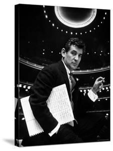 36 Year Old Composer Leonard Bernstein, Holding Musical Score with Lighted Auditorium Behind Him by Gordon Parks