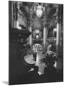 Allan Jay Lerner, and Frederick Loewe in Lobby of the Mark Hellinger Theater by Gordon Parks
