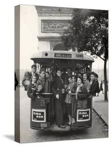 American Teenagers Riding Streetcar Towards Arc de Triomphe, Head Home by Gordon Parks