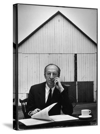 Composer Arron Copland Sitting at Table with Score in Front of Barn