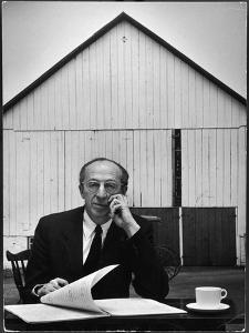 Composer Arron Copland Sitting at Table with Score in Front of Barn by Gordon Parks