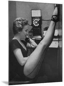 Dancer Mary Ellen Terry Talking with Her Legs Up in Telephone Booth by Gordon Parks