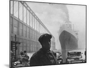 Dockworker Archie Harris Reflecting on Former Days as a Track Star by Gordon Parks