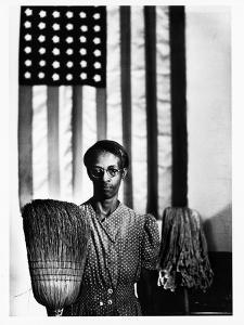 Ella Watson Standing with Broom and Mop in Front of American Flag, Part of Depression Era Survey by Gordon Parks
