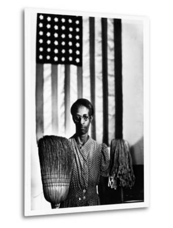 Ella Watson Standing with Broom and Mop in Front of American Flag, Part of Depression Era Survey