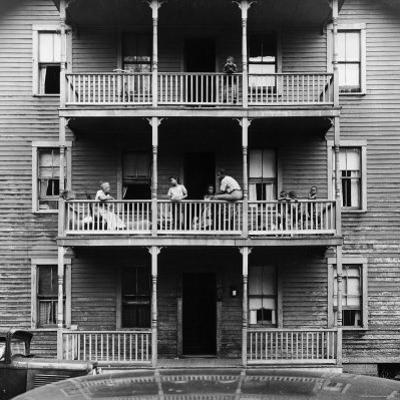 Family on Balcony of Apartment Building