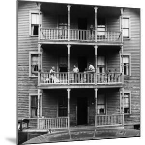 Family on Balcony of Apartment Building by Gordon Parks