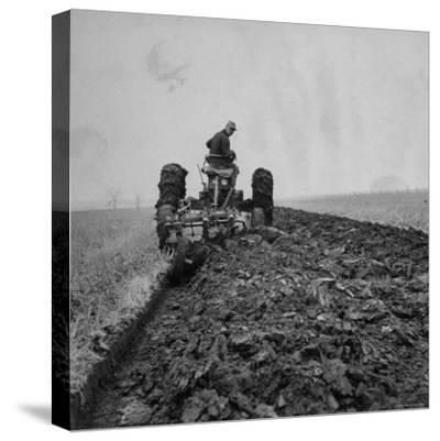 Farmer Plowing with a Tractor on an Iowa Farm