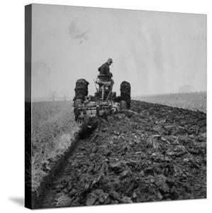 Farmer Plowing with a Tractor on an Iowa Farm by Gordon Parks