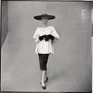 Fashion Model Showing Polka Dotted Smock Top over Black Skirt by Balenciaga by Gordon Parks