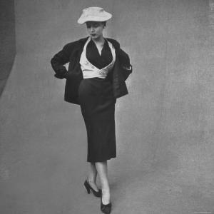 French Model Clad in Waistcoat with Box Jacket Outfit by Designer Christian Dior at Fashion Show by Gordon Parks