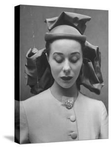 French Model Showing Off New Spring Hat Design by Gordon Parks