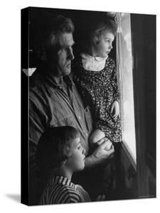 Grandpa with Grandchildren, Looking Out Kitchen Door, to a View He's Always Loved by Gordon Parks