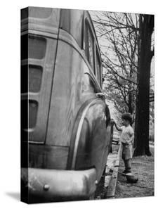 Happy Little Boy Assisting with Washing the Car by Gordon Parks