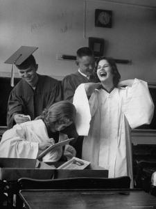 Hempstead High School Seniors Happily Helping Each Other with Graduation Gowns Before Commencement by Gordon Parks