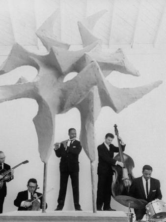 """Jazz Drummer Chico Hamilton Playing with Band Behind Sculpture Called """"Counterpoints"""""""
