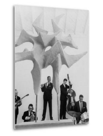 "Jazz Drummer Chico Hamilton Playing with Band Behind Sculpture Called ""Counterpoints"" by Gordon Parks"