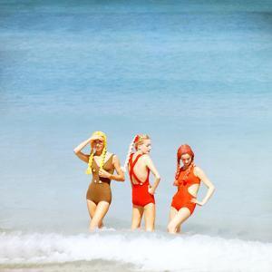 June 1956: Girls in Braided Wigs Modeling Beach Fashions in Cuba by Gordon Parks