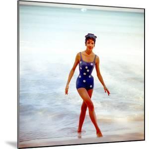 June 1956: Woman in Polka-Dot Swimsuit Modeling Beach Fashions in Cuba by Gordon Parks