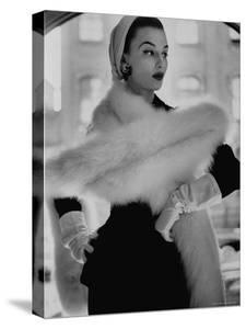 Lady Modeling a Boa Made Out of Six Rounded Skins of Natural White Fox, Selling For $350 by Gordon Parks