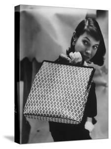 Model Displaying a Printed Leather Handbag by Gordon Parks