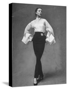 Model Showing Off Elegant White Organdy Shirt with Black Skirt by Lavin Castillo by Gordon Parks