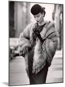 Model Wearing a Fringed Shawl Made of Natural Norwegian Blue Fox, Selling For $750 by Gordon Parks