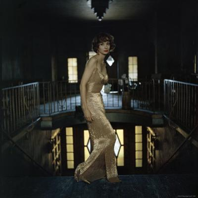 Model Wearing Gold Beaded Sheath Gown by Designer Helen Rose by Gordon Parks