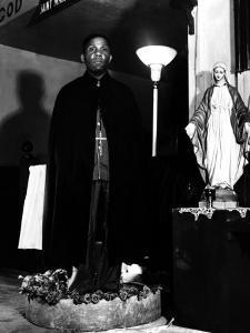 Pastor of the St. Martin's Spiritual Church, Flower Bowl Demonstration, Washington D.C., c.1942 by Gordon Parks