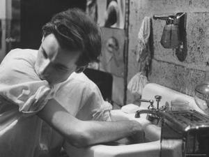 Pianist Glenn Gould Soaking His Hands in Sink to Limber Up His Fingers Before in Studio by Gordon Parks