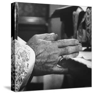 Praying Hands of Monk Churchman Resting on Table During Mass at St. Benedict's Abbey by Gordon Parks