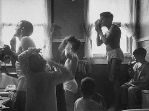 Professional Couple's Big Family, Sharing the Only Bathroom, Early in the Morning by Gordon Parks