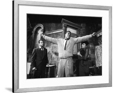"""Sidney Poitier in Dramatic Scene from Play """"A Raisin in the Sun"""", Actress Ruby Dee Visible on Right"""