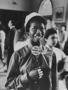 """Student Wearing Hat and Button on Shirt That Says: All I Want is Love on """"Old Clothes Day"""" by Gordon Parks"""