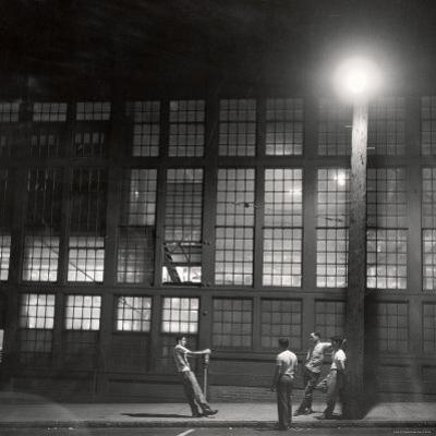 Teenage Boys Whiling Away a Summer Night on the Street