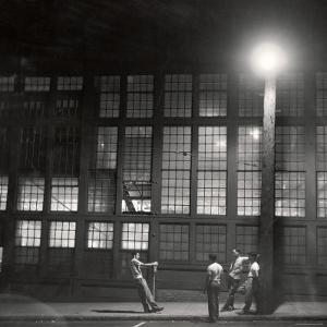 Teenage Boys Whiling Away a Summer Night on the Street by Gordon Parks