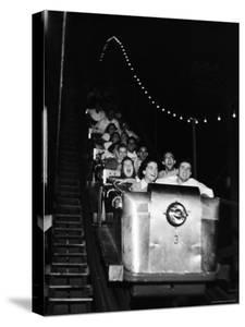 Teenagers in Rollercoaster at Night by Gordon Parks