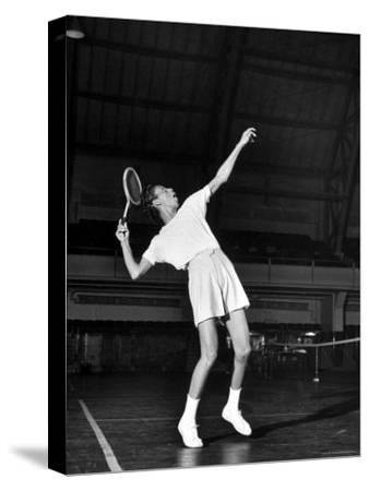 Tennis Player Althea Gibson, Serving the Ball While Playing Tennis