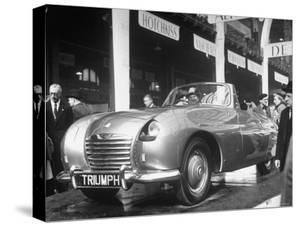 The British Triumph Roadster at the Paris Auto Show by Gordon Parks