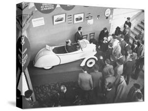 The Smallest Car at the Paris Auto Show, the Reyonnah by Gordon Parks