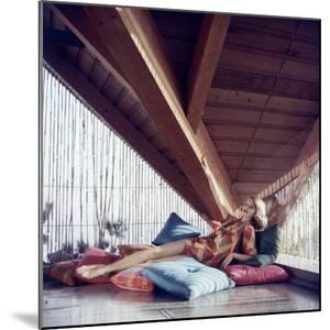 Woman Model Lounging on Pillows in Cabana Wearing Bikini Swimsuit Fashion. Cuba 1956 by Gordon Parks