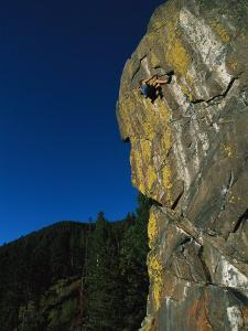 A Rock Climber Solo Climbs in Montanas Hyalite Canyon by Gordon Wiltsie