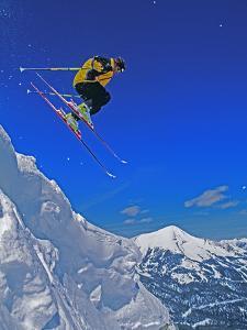 A Skier Jumps a Cornice at Exclusive Yellowstone Club Ski Area, Montana by Gordon Wiltsie