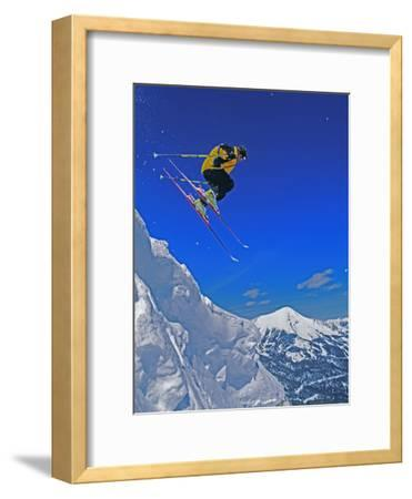 A Skier Jumps a Cornice at Exclusive Yellowstone Club Ski Area, Montana