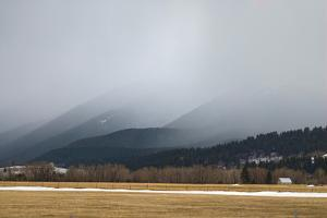 A Spring Storm Hovers over a Barn in Cottonwood Canyon of the Gallatin Range, Near Bozeman, Montana by Gordon Wiltsie
