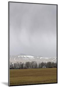 A Spring Storm Hovers over the Gallatin Valley, Near Bozeman, Montana by Gordon Wiltsie