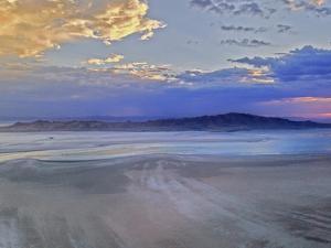 A Sunset Glows over Great Salt Lake and Antelope Island Near Salt Lake City, Utah by Gordon Wiltsie