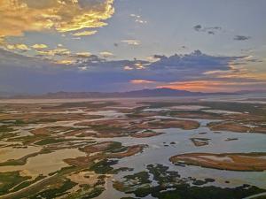 A Sunset Glows over the Marshy Shoreline of Utah's Great Salt Lake, Near Salt Lake City by Gordon Wiltsie