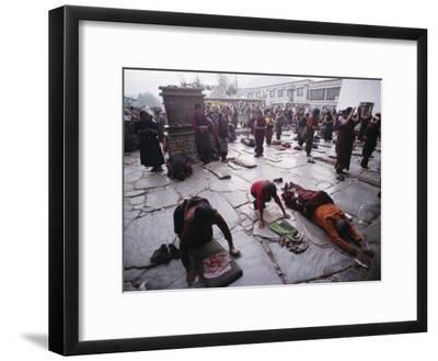 Buddhist Pilgrims Outside Jokhang Temple in Lhasa, Tibet