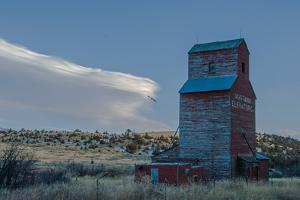 Lenticular Clouds Hover over an Abandoned Grain Elevator in the Gallatin Valley, North of Bozeman by Gordon Wiltsie